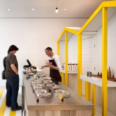 A pop-up Italian ice cream stall at St Martins Lane Hotel in London evokes the seaside with yellow beach huts and striped decking.