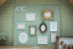 Table/seating plan using mismatched picture frames.  From 'An Elegant Summer Time and Vintage Inspired Gaynes Park Wedding'.  Photography by http://www.dominicwhiten.co.uk/