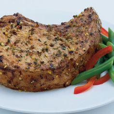 Garlic & Herb Pork Chops:  2 teaspoons McCormick® Perfect Pinch® Salt Free Garlic & Herb Seasoning,     4 bone-in pork chops, 1/2-inch thick (about 1 1/2 pounds) ,    1 tablespoon oil