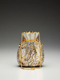 Purse by Judith Leiber, 1967...brushed gold with silver rhinestone crystals.