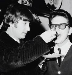 John feeding Roy Orbison, 1963.
