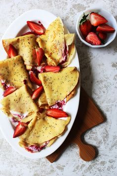 Poppy seed crepes with strawberries and yogurt