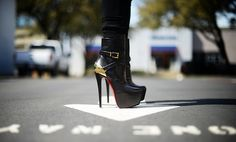 Christian LouboutinEquestria 160mm' Platform high heel boots with wrap-around buckled straps and gold-tone plated heel counter. [Image: Life in Travel]
