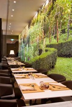 ...eco-friendly hotel with modern rooms, soothing tones of beige and floral wall art... **** Starhotels Echo, Milan, Italy