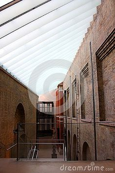 The glass roof connecting two old buildings in the Victoria and Albert museum in London, England.