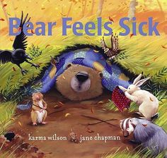 Bear Feels Sick by Karma Wilson, illustrated by Jane Chapman. When Bear is too sick to play, his animal friends go to his cave to make him soup and tea and keep him company. Find this under E WIL.