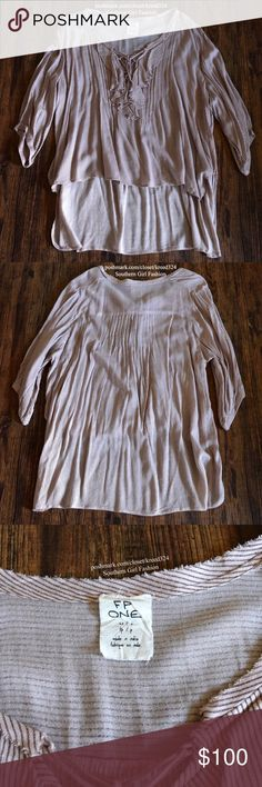 FREE PEOPLE Classic Top Patterned Bohemian Blouse Size XS/Small. New Without tags. $88 Retail + Tax.  • Effortless & oversized, this purple/red mix striped tunic top features ruffle accents at bust, 3/4 sleeves and an optional lace-up neckline closure. • High-Low style hemline; unlined silhouette.  • Rayon; red/purple color; FP ONE label. • Measurements provided in comment(s) section below.     {Southern Girl Fashion - Closet Policy}   ✔️ Same-Business-Day Shipping (10am CT). ✔️ Price shown…
