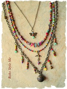 Rich in color, and boho style, this necklace is a timeless treasure. Created in 70's style, this long, multi strand, bohemian necklace is perfect for today's creative fashion. This necklace created using a vintage style brass pill box pendant, with magnetic closure. The pendant is