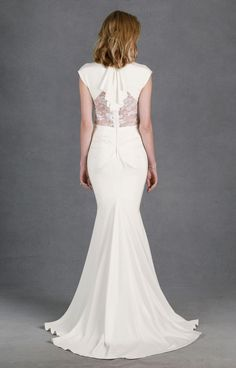 This deco-inspired bridal gown is made of crepe de chine, an airy and lightly textured silk. The cap sleeves and v-neck are bra-friendly yet elegant, and the...
