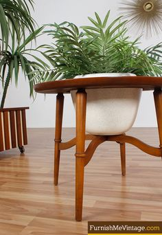 Mid century modern planter. Circular end table design with ceramic pot at center. Pot is removable. Novel atomic age design. Wood surface makes it possible to double as side table. Plant pictured is not included …