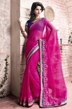 Dazzle in parties by draping this scintillating #Pink Soft #Net #party wear #designer embroidered #saree. En-crafted gracefully with fancy zari embroidery and lace border, the saree will surely lend a starry look to the wearer. Pair it with matching fashionable jewelry and high heels to complete the ethnic look.