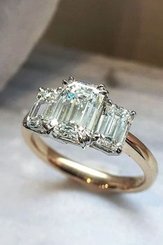 27 Eye-Catching Emerald Cut Engagement Rings ❤️ See more: http://www.weddingforward.com/emerald-cut-engagement-rings/ #wedding #engagementrings