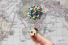 This fun new pin cushion by UK designer Clive Roddy promises to elevate your pushpin storage in a manner reminiscent of the Pixar film Up. The tiny wooden house with a large cork sphere can sit on a d Balloon Shapes, The Balloon, Plywood House, Balloon Clusters, Der Computer, Travel Maps, Travel Themes, Pin Cushions, Special Gifts