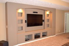 Built-in drywalled entertainment center modern media room