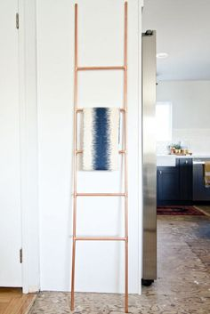DIY Copper Pipe Ladder, tutorial via Brittany Makes