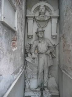 Recoleta Cemetery, Argentina ~ David Alleno was an Italian immigrant who dreamed of being buried in the prestigious cemetery where he worked as a caretaker from 1881 to 1910. He saved enough money to buy a space  built his own tomb. He even traveled back to his home country to find an artist who could carve his figure in marble, complete with keys, broom  watering can.