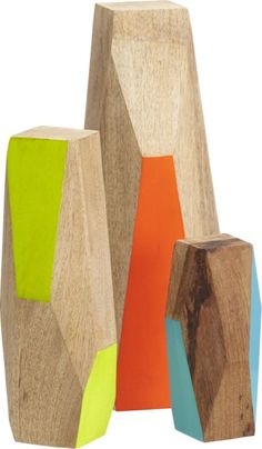 Cute table decor set available at CB2. This would also be a fun at-home project.  3-piece mango wood guardian set  | CB2