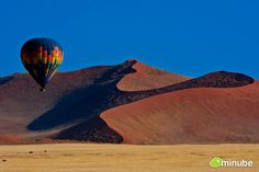 3.) Namib-Naukluft Park, Namibia - The Namib-Naukluft is a sprawling natural park which encompasses rugged mountains and the world's oldest desert: the Namib. Where else can you walk between hypnotically-colored, 65-million-year-old sand dunes the size of the Empire State Building? (Photo by Javier A. Garcia)