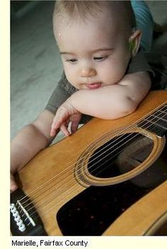 This little guy already has that 'contemplative musician' look down- watch out now!