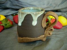 Ceramic Footed Mug in Winter Blue, Black Mountain and Speckled Brown by Sally Anne Stahl. www.clayshapergallery.com