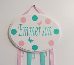 A personal favorite from my Etsy shop https://www.etsy.com/listing/293406509/personalized-hair-bow-holder-hair-bow