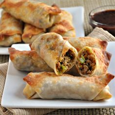Spicy Pork and Vegetable Crispy Baked Egg Rolls by pinchandswirl: Try some savory plums sauce for a dip or you could also combine soy sauce, rice vinegar, sriracha and toasted sesame oil (all to taste) for a simple and delicious dip. #Egg_Rolls #Pork #Cabbage #Carrot #Baked #Spicy