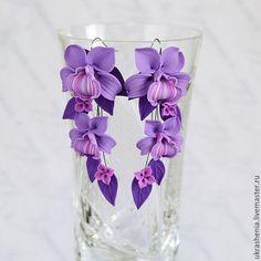 Earrings long with purple orchid flowers.