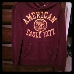 American Eagle hoodie Soooo soft!!! Maroon AE hoodie, it's a men's size extra small and fit me when I wore mediums and smells in women's. Great condition, only worn a few times. I did take the string out though. Other than that it's in near new condition! Did I mention it's extremely soft??!!  American Eagle Outfitters Tops Sweatshirts & Hoodies