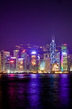 The Symphony of Lights, Hong Kong. Expect a sky filled with lasers and music all choreographed to an intricate lightshow played out on a wall of imposing skyscrapers. Click pin through to post for more info.
