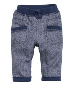 Jersey-lined pants in woven cotton fabric with elastication and decorative drawstring at waist and front pockets.