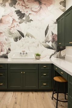 A laundry room that is one of the prettiest rooms in the house. One of our favorite details in this laundry room is the wallpaper Benjamin Moore Forest Green cabinets. A Finer Touch Construction Green Kitchen Cabinets, Laundry Room Cabinets, Kitchen Countertops, Marble Countertops, Kitchen Laminate, Laminate Countertops, Black Cabinets, Bathroom Wallpaper Green, Laundry Room Wallpaper