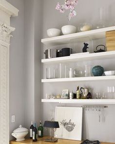 White floating shelves gray wall. http://cococozy.com