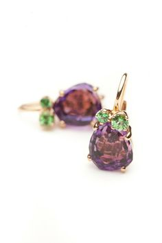 Highly faceted, light catching amethysts are perfectly paired with lush green tsavorites.  Prong set in 18kt. rose gold.