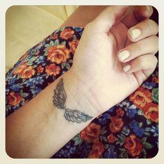 Wing, wrist tattoo on TattooChief.com