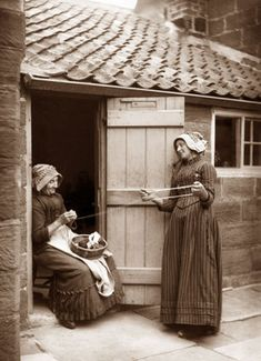 Frank Meadow Sutcliffe :  Two women winding wool.  Ref: E5