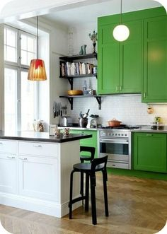 Try giving your cupboards a facelift!  Keeping the majority of you kitchen neutral the green will pop and make the perfect statement come dinner time!