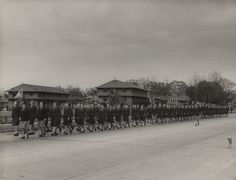 Q49359 - Members of the Women's Army Corps and the Women Airforce Service Pilots marching at Brookley Field in Mobile, Alabama. (ADAH)