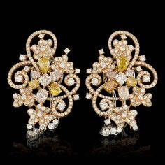 These elegant ladies earrings is crafted in solid 18k Multi-Tone Gold and features 6 (1.31 ctw) 100% Natural Diamonds + accented with 8 sparkling eye-clean natural Diamonds, totaling 1.50 carats and 336 Diamonds, totaling 3.15 carats. Excellent craftsmanship.