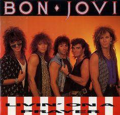 "Bon Jovi,""Livin' on a Prayer"" is Bon Jovi's second single from their Slippery When Wet album. Written by Jon Bon Jovi, Richie Sambora, andDesmond Child. Jon Bon Jovi, Pop Internacional, Hard Rock Music, 80s Hair Bands, Nostalgia, Blues, Pop Songs, Radios, 80s Music"