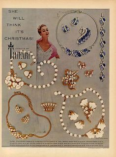 1953 Jewelry Ad for Trifari Jewelry. Note the white necklaces similar in style to the Trifari  white glass flower pin shown in the banner on this page. The flower pin was actually part of the 'Woodland Fantasies' series which was introduced in 1949 however, white jewelry became quite popular during the 50s, especially during the summer months. This ad shows that the 'fine look' trend of the 50's  co-existed with a trend towards a 'faux' look as seen in the while glass sets.