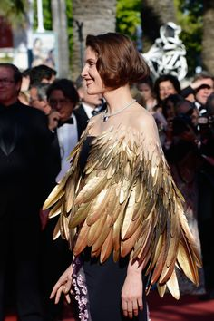 Cape Lookbook: Laetitia Casta wearing Cape (16 of 34). Laetitia paired a golden winged bolero over her purple gown for an added touch of whimsy!