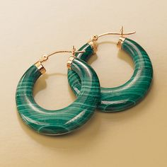 Malachite is primarily a vibrant green hue. This stone was used as a mineral pigment in paint until the 19th century. It was named in Greek after its resemblance to a plant species. >>Click on the malachite hoop earrings to see more malachite gemstone jewelry styles.