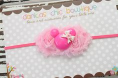 Mini light pink double shabbys with dark pink minnie mouse center made by Danica's Chic Bowtique. $9 plus shipping.