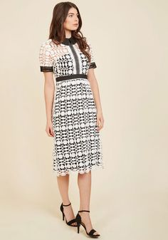 Every great wardrobe is built on one powerful piece - let this black and white shirt dress be yours. With the the crisp black collar, sheer neckline, and delicate ladder sleeve trim of this crocheted lace midi in your arsenal, you can take on any occasion knowing you're styled to sublimity.