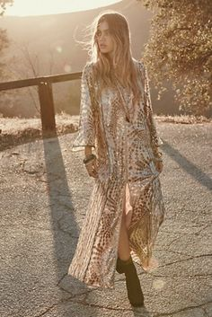 DEF need something like this! #maxidress #FP Silver Maxi | Free people shine bright in this beautiful American made embroidered maxi, adorned with silver sequins that catch the light at each turn. Featuring a slight V-neckline and high front slit. Wide, sheer sleeves. Fully lined.