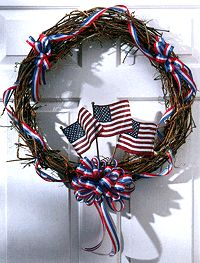 Independence Day (July 4, 1776) or Memorial  Day  (last Monday of May, Civil War) or Veteran's Day (November 11th, 1918):  wreath