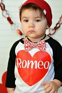 Boys+'Romeo'+Valentine's+Day+shirt+by+Liv+&+Co.™+is+a+must+have+for+your+little+mans+wardrobe+for+anytime+of+year.++Your+super+soft+shirt+will+come+on+a+soft,+comfy,+50/50+cotton/poly,+raglan+sleeved+baby+or+toddler+baseball+tee+(as+pictured)!++Be+the+best+gift+-+giver+at+the+baby+shower+with+this+adorable+little+one+piece+or+shirt!++These+shirts+are+an+American+Apparel+brand,+design+by+Liv+&+Co.+making+these+100%+MADE+IN+THE+USA!++There+isn't+a+better+baby+shower+gift+than+a+Liv+&am...