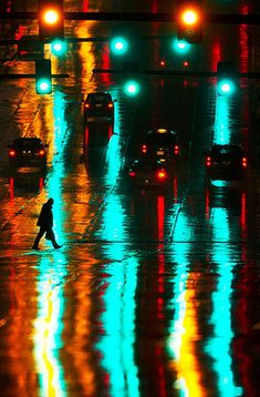 Corey Perrine/Omaha World-Herald | Before rain turned into snow less than 12 hours later, a man crosses Saturday, Dec. 3 at around midnight crossing Dodge Street on 16th Street in downtown Omaha, Neb. Precipitation would turn to rain as temperatures fell through the night. Copyright: Omaha World-Herald