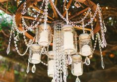 Give an old lighting fixture a makeover with blue mason jars in this step-by-step tutorial for a DIY mason jar chandelier. Hanging Candle Chandelier, Outdoor Chandelier, Chandelier Ideas, Chandelier Wedding, Rustic Chandelier, Homemade Chandelier, Wagon Wheel Chandelier, Beaded Chandelier, Chandelier Lighting