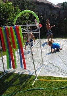 29. DIY Slip N' Slide  Plastic sheeting! I would have never thought of this. If you've got a hose, I think the kids could manage to have a lot of fun. I'm also digging the PVC pipe sprinkler and hanging pool noodles.
